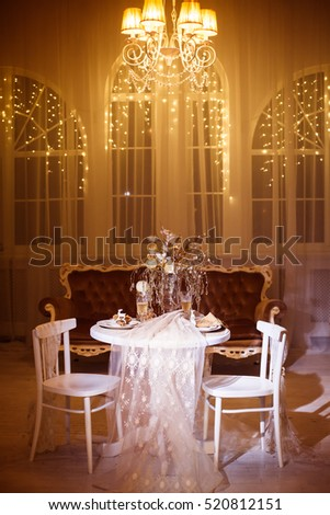 Chandelier light stock images royalty free images vectors holiday dinner table for two shined by classic chandelier light large windows decorated with warm aloadofball Image collections