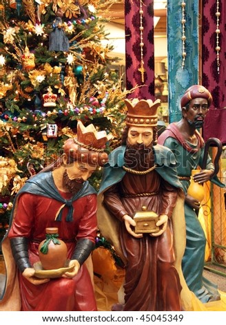 Holiday display with the three wise men and a Christmas tree - stock photo