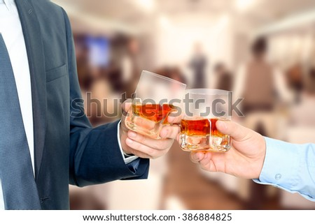 Holiday Event business people cheering each other with Whiskey - stock photo