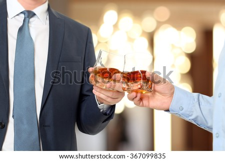 Holiday Event  business people cheering each other with Whisky - stock photo