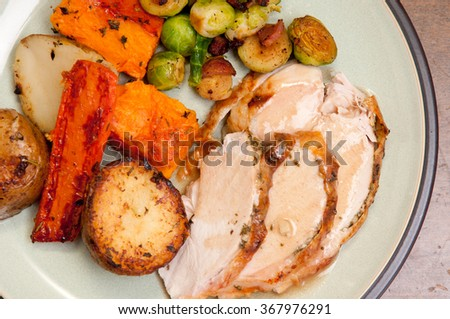 holiday feast turkey dinner with cranberry sauce, roasted vegetables and brussels sprouts - stock photo