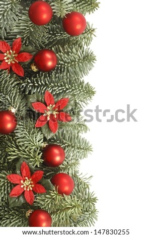Holiday frame with Christmas tree branches and decorations on white background