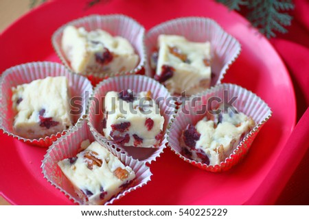 Holiday fudge made from white chocolate, dried cranberries and pecans