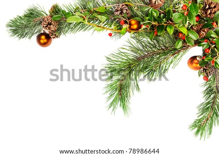 Holiday garland with ornaments, pine branches, pine cones and evergreen with berries (Common Bearberry/Kinnikinnick) - stock photo