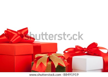 Holiday gift box background with red ribbon bow, close up view, isolated on white background