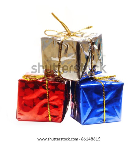 Holiday gift boxes decorated with ribbon - stock photo