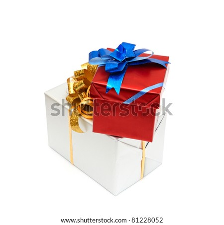 Holiday gift boxes decorated with ribbon isolated on white - stock photo