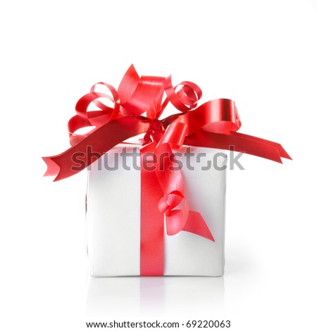Holiday gift with red ribbon isolated on white - stock photo
