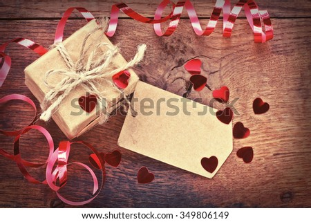 holiday gift wrapped in paper, Valentine's Day, confetti and ribbons