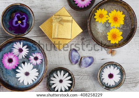 Holiday gifts concept elegant design with flowers and gift boxes. Top view. - stock photo