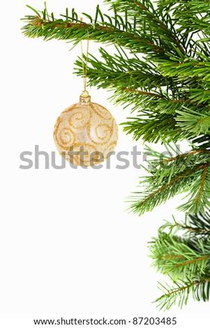 Holiday golden ball on christmas tree - stock photo