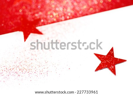 Holiday greeting card. Blurred Christmas background with stars. Red and white traditional colors, Selective focus, space for your text.  - stock photo