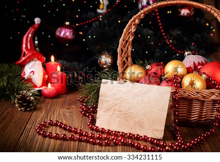 Holiday greeting card with Christmas decorations and candles and place for text - stock photo