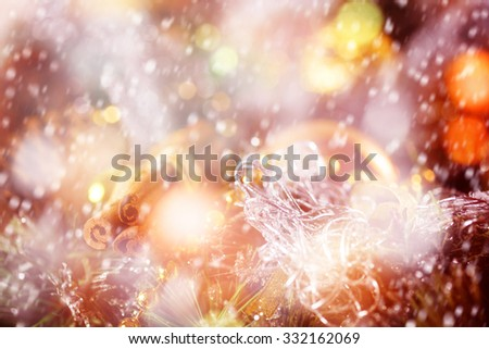 Holiday Greeting Card with Cinnamon Sticks and Blurred Christmas Lights and Sparkles at the Background with Drawn Snow for Festive Mood. Bright Gold Colors. Selective Focus, Space for Text. - stock photo