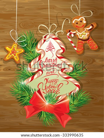 Holiday greeting Card with xmas gingerbread - man and star cartoons, candy and fir-tree branches. Hand written calligraphic text Merry Christmas and Happy New Year on wooden background. Raster version - stock photo