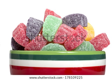 Holiday gumdrop candy in a variety of colors and flavors in a festive bowl - stock photo