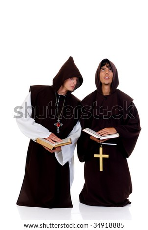 Holiday Halloween scene, two priests in habit.  Studio, white background.