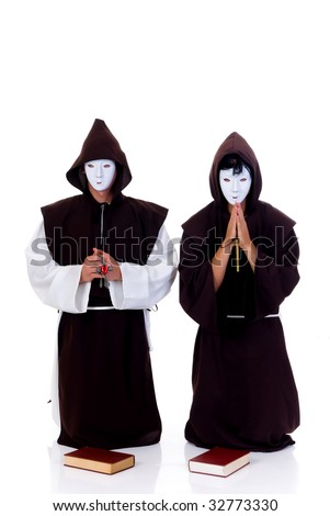 Holiday Halloween scene, two priests in habit with white mask.  Studio, bleached background. - stock photo