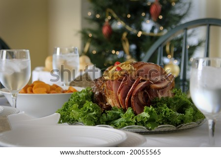 Holiday ham dinner table setup - stock photo