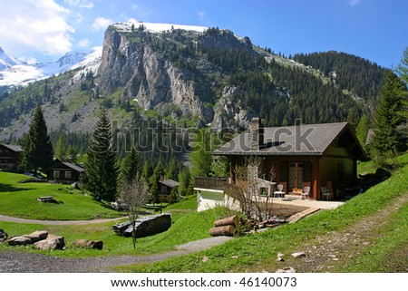 Holiday houses in Swiss Alps - stock photo