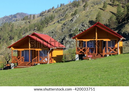 Holiday houses. Russia, Altai. - stock photo