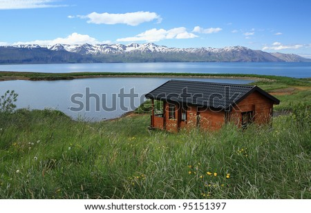 Holiday hut with a view near the whale watching town of Husavik in Iceland - stock photo