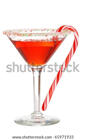 Holiday martini with a candy cane - stock photo
