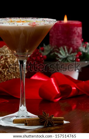 holiday martini with a sugar rim and lime and orange zest on top served on a table with decorations - stock photo