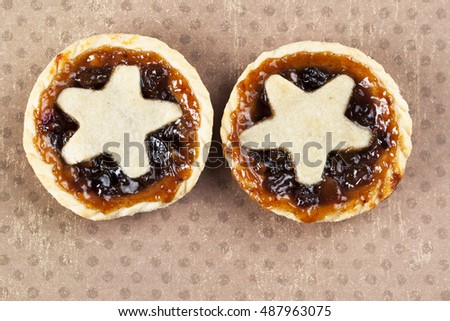 Holiday mince pies with star shape, viewed from above.