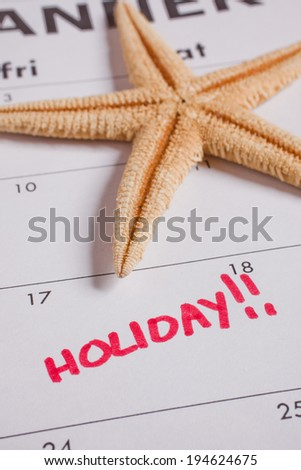 Holiday on calendar - stock photo