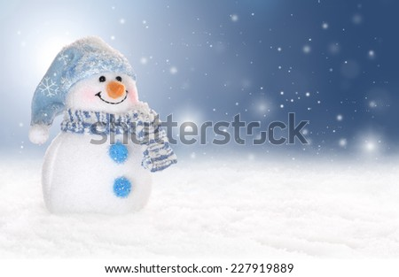 Holiday or winter background with a cute, cheerful snowman in snow