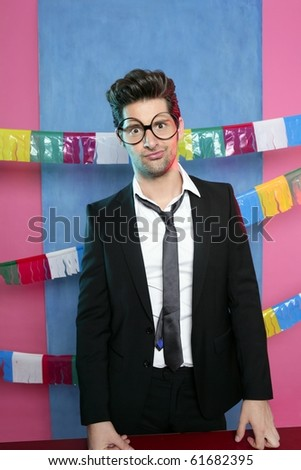 Holiday party young man funny glasses and suit - stock photo