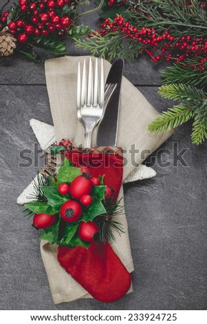 Holiday place setting. Christmas stocking place settings with festive decorations.Done with vintage retro filter.  - stock photo