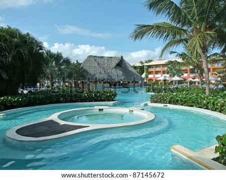 holiday resort with pool at the Dominican Republic, a island of Hispanola wich is a part of the Greater Antilles archipelago in the Carribean region - stock photo