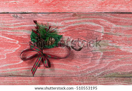 Holiday ribbon on rustic red wooden boards. Overhead view with copy space.