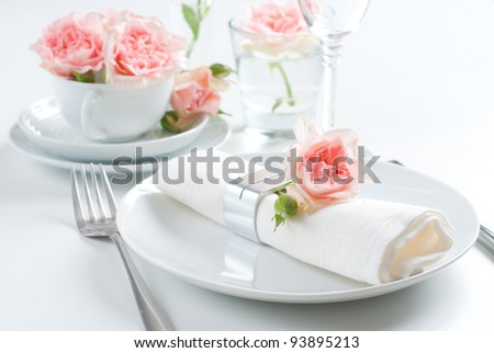 Holiday romantic table setting with pink roses on a white background - stock photo