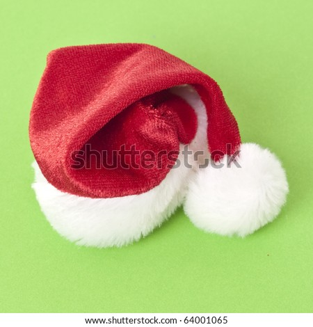 Holiday Santa Hat on a Vibrant Green Background. - stock photo