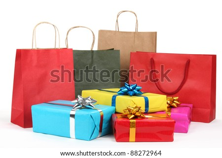 Holiday shopping bags and gift boxes on white background - stock photo