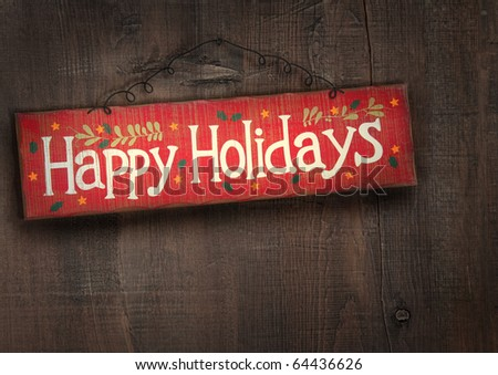 Holiday sign on distressed wooden wall - stock photo