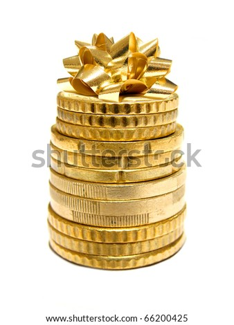 Holiday spending - a stack of coins with a gift bow on top - stock photo