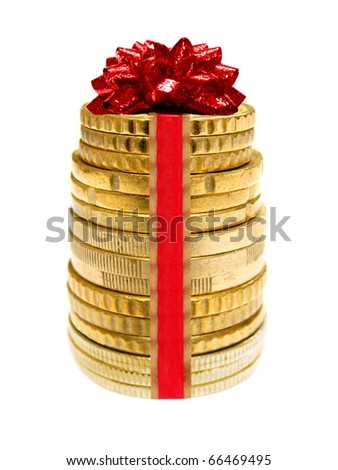 Holiday spending - a stack of coins wrapped with ribbon and red bow - stock photo