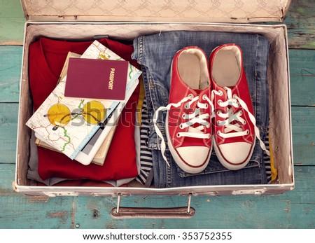 Holiday suitcase - stock photo