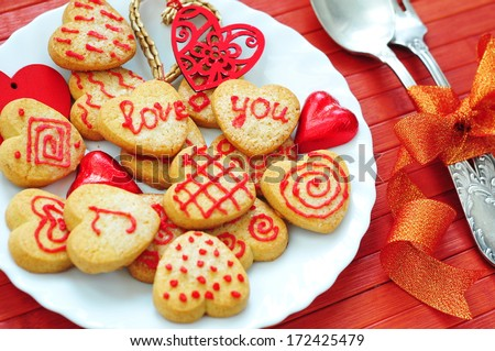 Holiday table setting and Cookies in Shape of Heart at Valentine Day  - stock photo