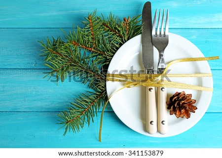 Holiday table setting with Christmas decoration - stock photo