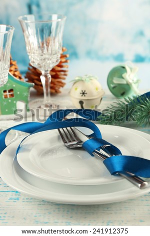 Holiday table setting with Christmas decoration and light background - stock photo