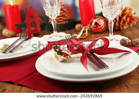 Holiday table setting with Christmas decoration background - stock photo
