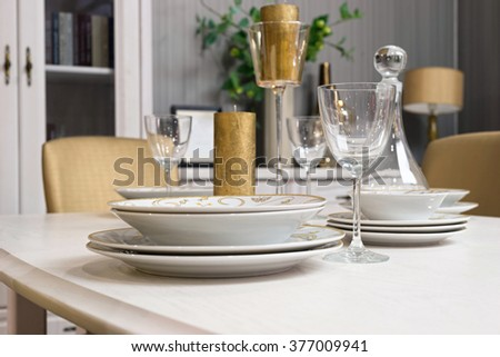 Holiday table setting with gold candles