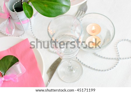 Holiday tableware in white and pink colors