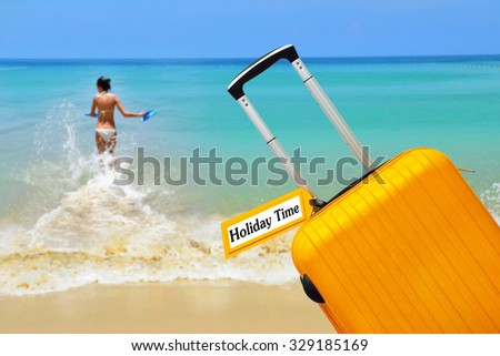 Holiday Time. Suitcase with label word. - stock photo