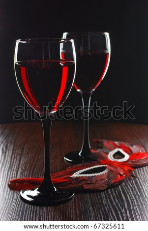 Holiday.Two glass of red wine and mask